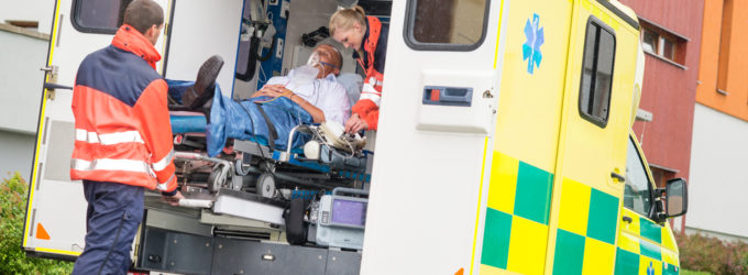 Person getting loaded into an ambulance, when should you hire a workman's comp attorney